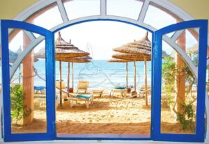 Download the design of the wall poster of the window facing the sea and the chair