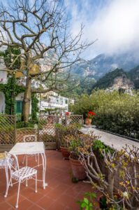Download the poster design of the chair terrace, tree and mountain